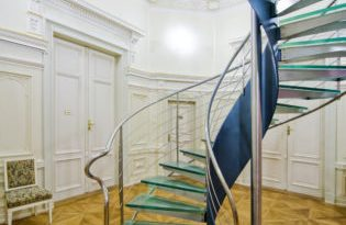 Modern spiral staircase  in historical setting - interior